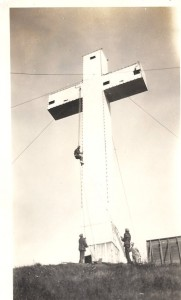 Putting bulbs back on cross after painting Side Of Mt. Davidson Coss1928
